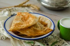 Traditional turkish borek, ciborek on the wooden table, stock photos
