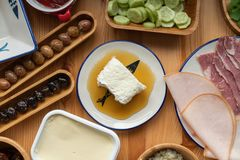 Traditional Turkish Breakfast, eggs with sucuk, bal kaymak, oli royalty free stock images
