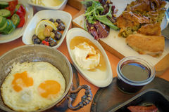 Traditional Turkish breakfast with plates of various food option Stock Photos
