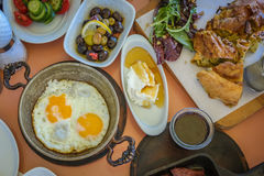 Traditional Turkish breakfast with plates of various food option Royalty Free Stock Photos
