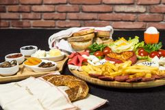 Traditional Turkish breakfast with cheese, salami, boiled egg, tomato, cucumber, fried potatoes and toasted bread. Traditional Turkish breakfast served with stock images