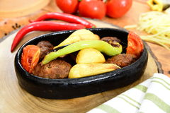Traditional turkish Casserole meatball. Traditional Turkish Food and Concept Stock Image