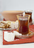 Traditional turkish chai. In glasses, served with two sugar cubes and turkish delight Royalty Free Stock Photo
