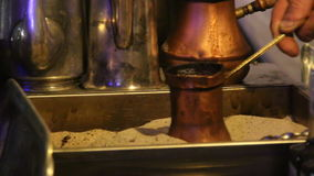 Traditional turkish coffee being prepared in hot sand stock video