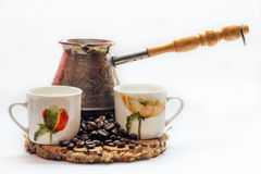 Traditional Turkish coffee a cezve, isolated on a white background Royalty Free Stock Photos