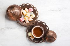 Traditional turkish coffee and turkish delight on white shabby wooden background.  Top view Stock Images