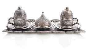 Traditional turkish coffee set. Traditional turkish ornate metal tray with two coffee cups isolated on white Royalty Free Stock Image