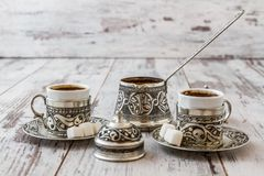 Traditional Turkish Coffee. In traditional silver cup with silver pot and tray Royalty Free Stock Images