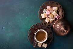 Traditional turkish coffee  and turkish delight on dark green wooden background. flat lay Royalty Free Stock Image