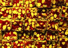 Traditional Turkish delight with nuts. Traditional turkish delight - rahat lokum with nuts. Tasty background Stock Images