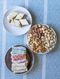 Traditional Turkish Delight. Oriental dessert halva on a  plate. Isolated on background. Eastern delicacy sweets. Healthy food. Nuts mix assortment. Collection royalty free stock photo