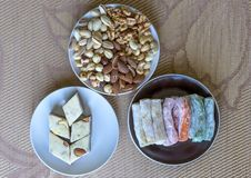 Traditional Turkish Delight. Oriental dessert halva on a  plate. Isolated on background. Eastern delicacy sweets. Healthy food. Nuts mix assortment. Collection stock photo