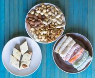 Traditional Turkish Delight. Oriental dessert halva on a  plate. Isolated on background. Eastern delicacy sweets. Healthy food. Nuts mix assortment. Collection royalty free stock images