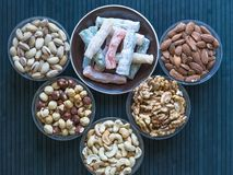 Traditional Turkish Delight. Oriental dessert on a  plate. Isolated on background. Eastern delicacy sweets. Healthy food. Nuts mix. Assortment. Collection of royalty free stock photography