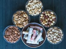 Traditional Turkish Delight. Oriental dessert on a  plate. Isolated on background. Eastern delicacy sweets. Healthy food. Nuts mix. Assortment. Collection of stock photos