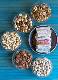 Traditional Turkish Delight. Oriental dessert on a  plate. Isolated on background. Eastern delicacy sweets. Healthy food. Nuts mix. Assortment. Collection of stock photography