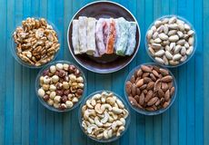 Traditional Turkish Delight. Oriental dessert on a  plate. Isolated on background. Eastern delicacy sweets. Healthy food. Nuts mix. Assortment. Collection of stock images
