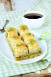 Traditional Turkish dessert - baklava with honey Stock Photos