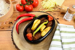 Traditional Turkish food casserole and red paper, tomato. Traditional Turkish Food and Concept Royalty Free Stock Photo