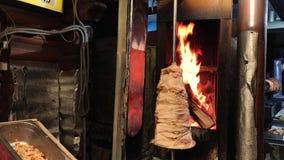 Traditional Turkish food Doner Kebab. Turnspit skewing kebap or kebab on metal skewer in the kebab restaurant. Shawarma meat being stock video footage