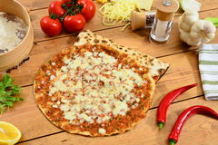 Traditional Turkish food lahmacun and red paper. Traditional Turkish Food and Concept Royalty Free Stock Photo