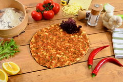 Traditional Turkish food lahmacun and wood background. Traditional Turkish Food and Concept Stock Photo