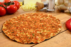 Traditional Turkish food lahmacun and wood background. Traditional Turkish Food and Concept Stock Images