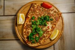 Traditional Turkish food Lahmajun on a wooden tray. View from above royalty free stock photography