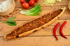 Traditional turkish food minced pide , Wood background Pita. Traditional Turkish Food and Concept royalty free stock image