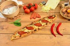 Traditional turkish food salami pide , Wood background Pita. Traditional Turkish Food and Concept Royalty Free Stock Photo