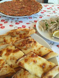 Traditional turkish food on table (lahmacun and pide) Royalty Free Stock Photo