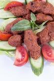 Traditional Turkish foods; bulgur kofte cig kofte. Traditional delicious Turkish foods; bulgur kofte cig kofte royalty free stock images