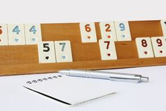 Traditional Turkish game okey, plastic chips with numbers on a wooden stand stock images