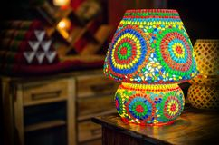 Traditional turkish glass table lamp. On a wooden desk Royalty Free Stock Photos