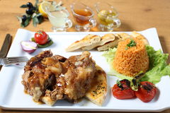 Traditional turkish lamb with bulgur pilav. Vegetables, bread and lemon juice, olive oil Stock Images