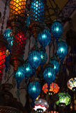 Traditional turkish lamps hanging at the Grand. Group of traditional multicolored turkish lamps hanging at the Grand Bazaar in Istanbul, Turkey Royalty Free Stock Photography
