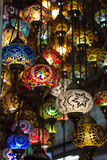 Traditional turkish lamps hanging at the Grand. Group of traditional multicolored turkish lamps hanging at the Grand Bazaar in Istanbul, Turkey Stock Photos