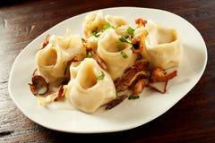 Traditional Turkish manti pasta with mushrooms stock photo