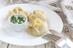 Traditional Turkish manti with sour cream sauce Stock Images