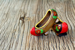 Traditional Turkish a Pair of Clog With Attractive Style and Colorful on a wooden table. Blur backround Stock Image