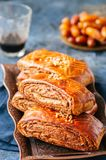 Traditional turkish pastry roll with chocolate and nuts - pastic. Traditional turkish pastry roll with chocolate and nuts filling - pastich served on a vintage Stock Photography