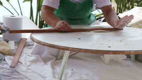 Traditional Turkish pastry. Woman using a rolling pin to roll and smooth out her dough. Turkish pastry stock footage
