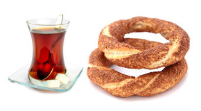 Traditional Turkish sesame bagel (simit) and Turkish tea Royalty Free Stock Images