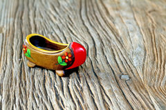 Traditional Turkish Single Clog With Attractive Style and Colorful on a wooden table. Cultural object for local culture Royalty Free Stock Photography
