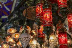 Traditional turkish style lamp from grand bazaar. A device for giving light, either one consisting of an electric bulb together with its holder and shade or Royalty Free Stock Images