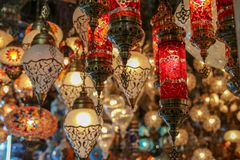 Traditional turkish style lamp from grand bazaar. A device for giving light, either one consisting of an electric bulb together with its holder and shade or Royalty Free Stock Photo