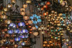 Traditional turkish style lamp from grand bazaar. A device for giving light, either one consisting of an electric bulb together with its holder and shade or Stock Photo