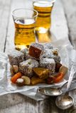 Traditional turkish sweet lukum served with tea Royalty Free Stock Photos