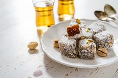 Traditional turkish sweet lukum served with tea Royalty Free Stock Photo