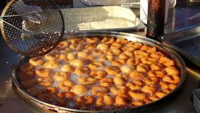 Traditional Turkish Sweet Pastry Frying In Hot Oil stock footage